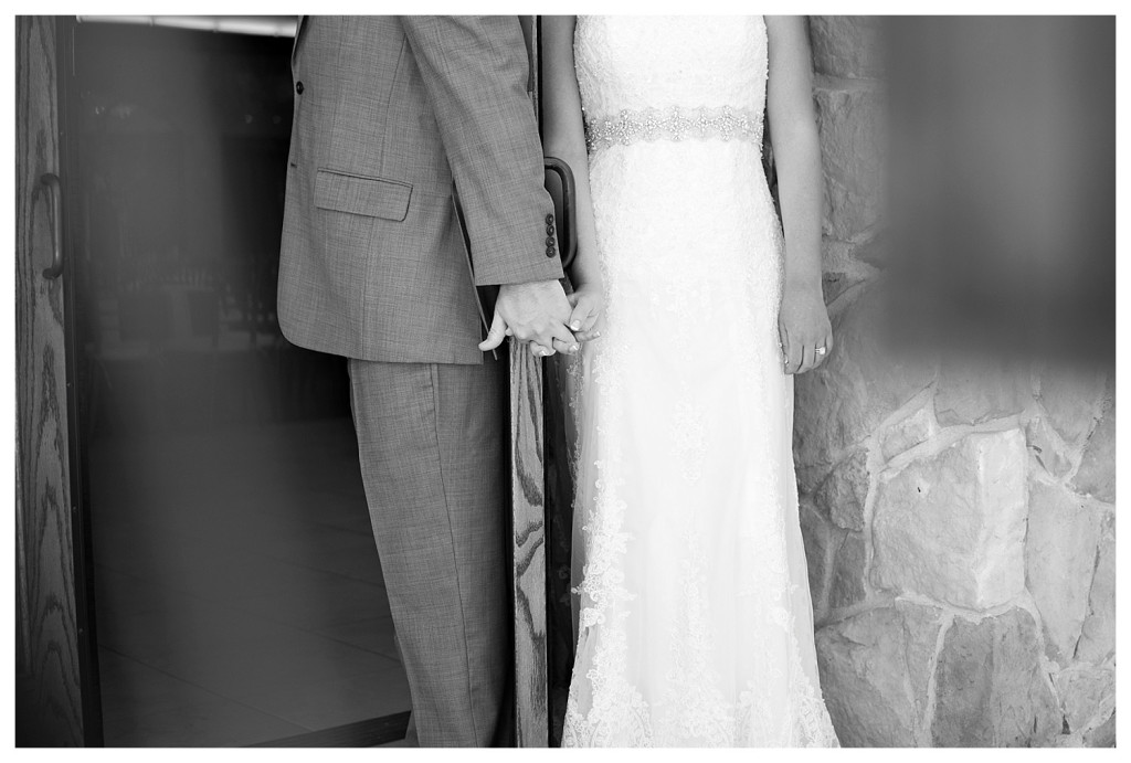 First look holding hands at Baldoria on the water wedding Denver Colorado