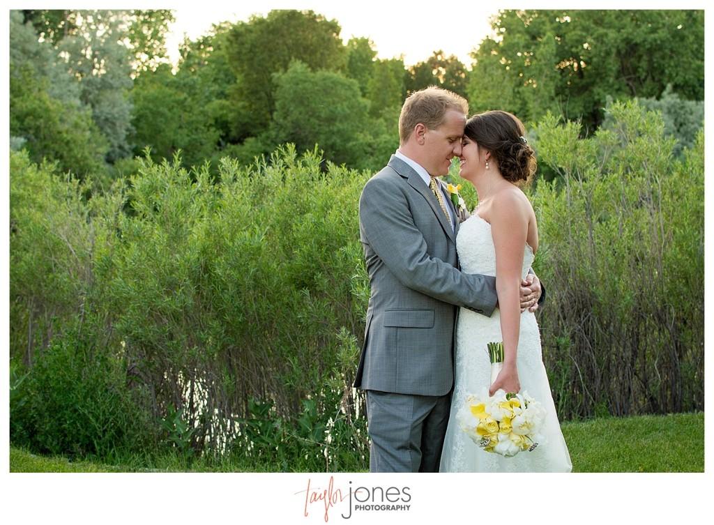 Bride and groom at Reception at Baldoria on the water wedding Denver Colorado