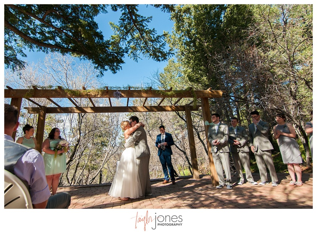 First kiss at Ceremony at Pines at Genesee wedding for Cortney and Matt