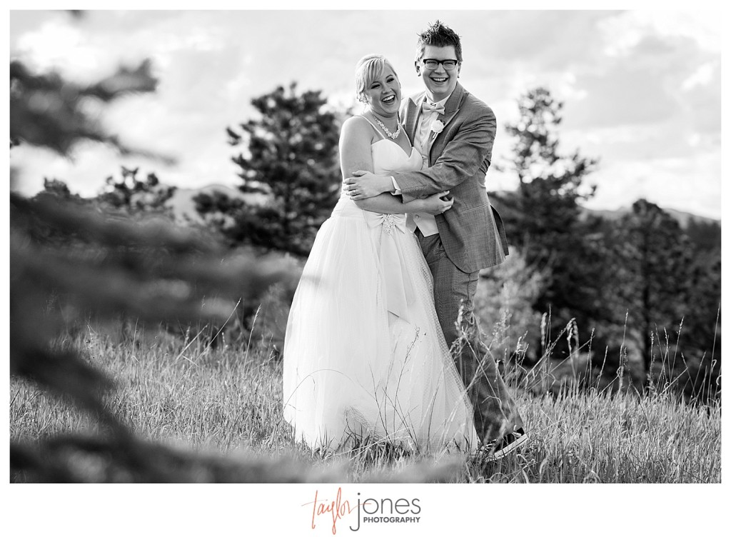 Bride and groom portraits dancing at Pines at Genesee wedding with mountains