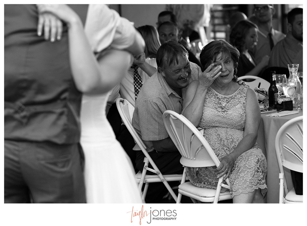 Mother of the groom crying during father daughter dance at Pines at Genesee wedding reception