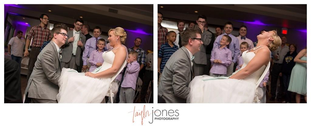 Garter toss at Pines at Genesee wedding reception