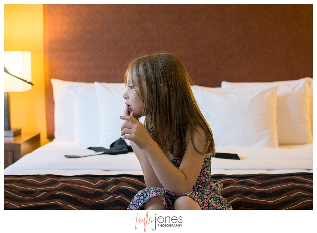 Flower girl watching Bride getting ready at Golden hotel wedding in Golden, Colorado