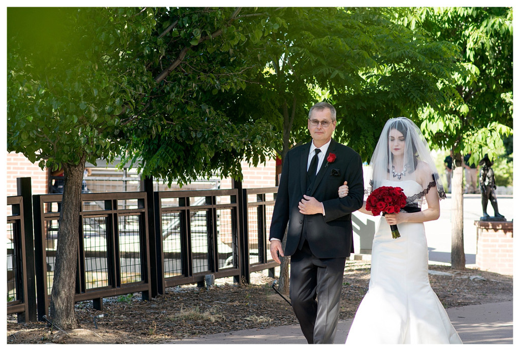 Bride and father coming down the aisle at ceremony at Golden Hotel wedding Golden Colorado