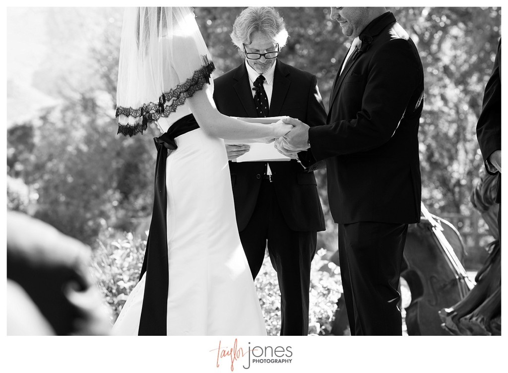 Bride and groom holding hands at ceremony at Golden Hotel wedding Golden Colorado