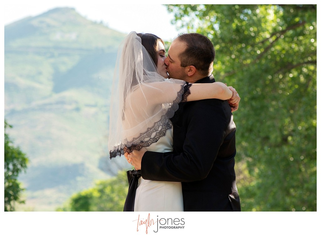 First kiss at ceremony at Golden Hotel wedding Golden Colorado