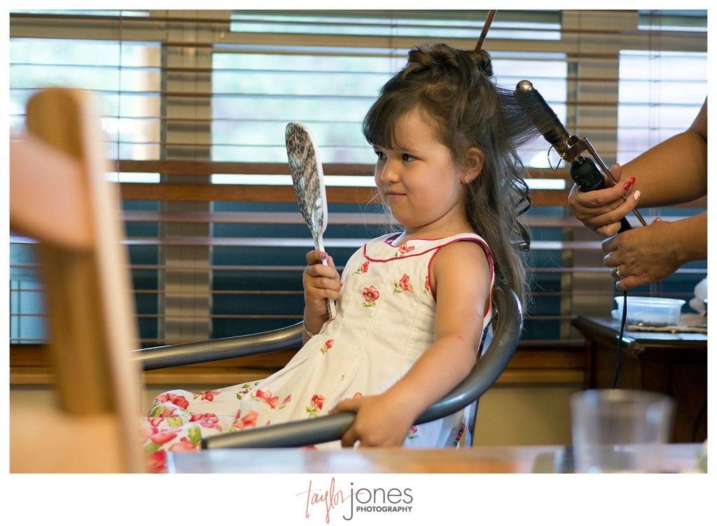 Flower girl getting ready for wedding at Mt. Vernon Country Club in Golden, Colorado