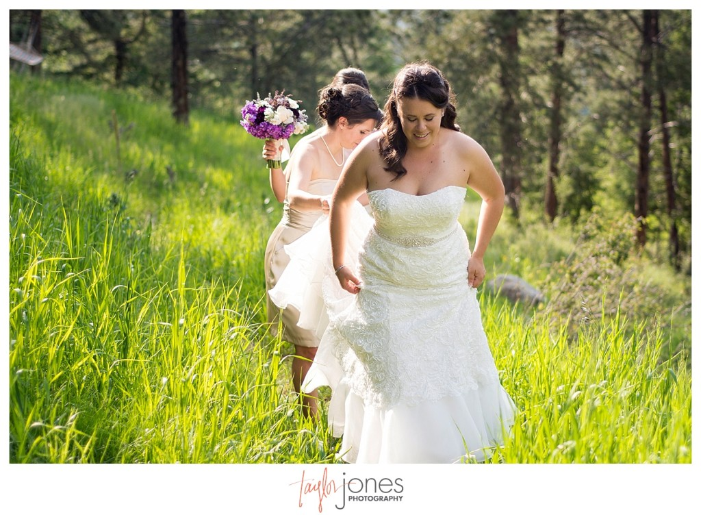 Bridesmaids carry brides dress at Mt. Vernon Country Club wedding in Golden, Colorado