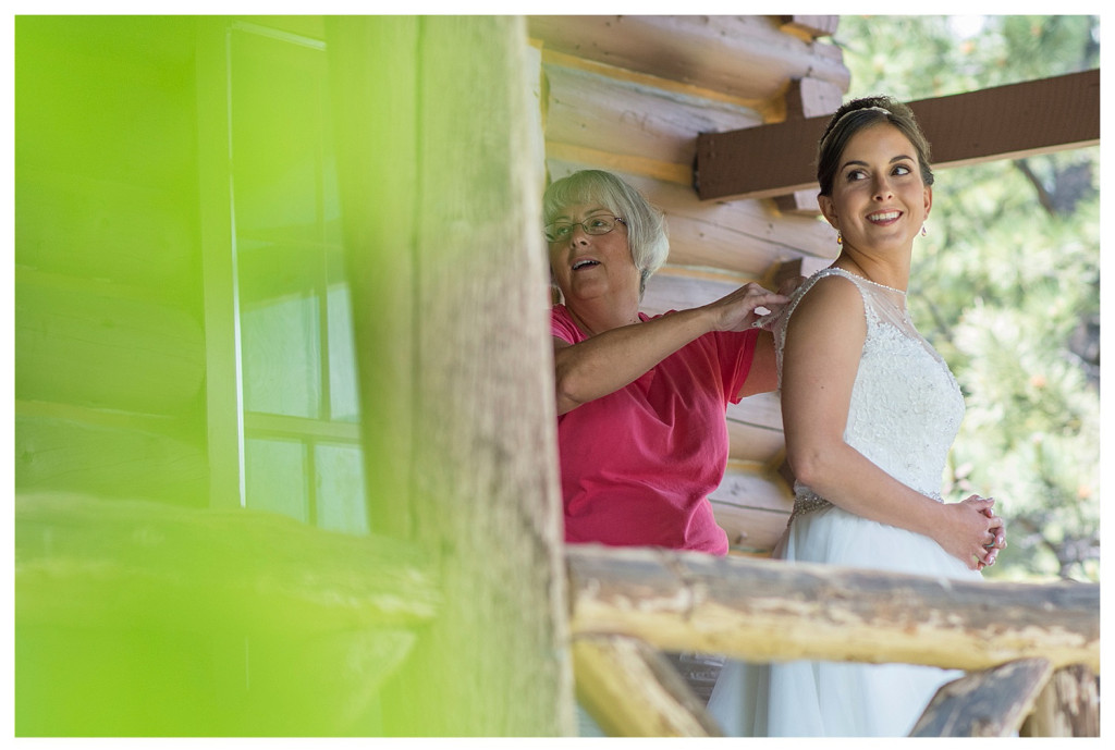 Bride and mother getting dressed at YMCA of the Rockies in Estes Park, Colorado