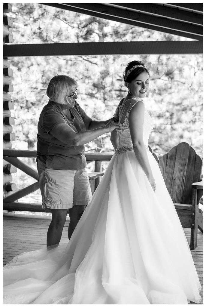 Bride getting dressed at YMCA of the Rockies in Estes Park, Colorado