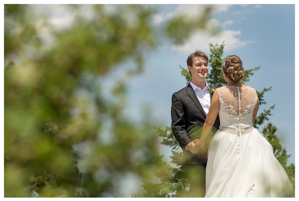 First look with bride and groom in mountains at YMCA of the Rockies in Estes Park, Colorado