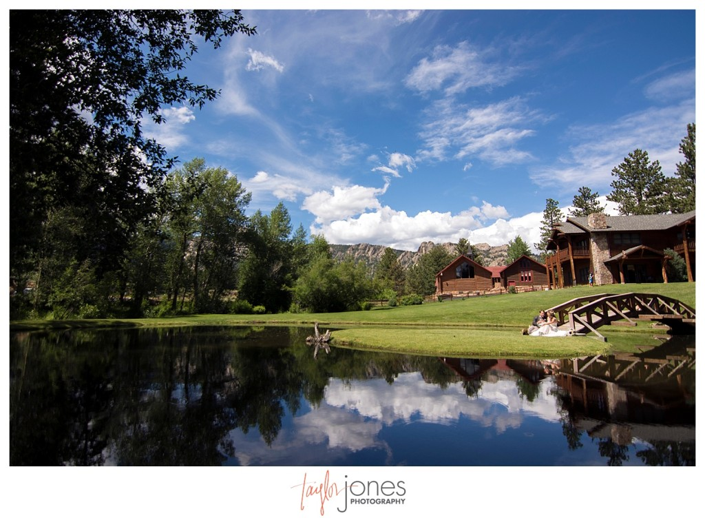 Black Canyon Inn Estes Park wedding first look with bride and groom wide angle