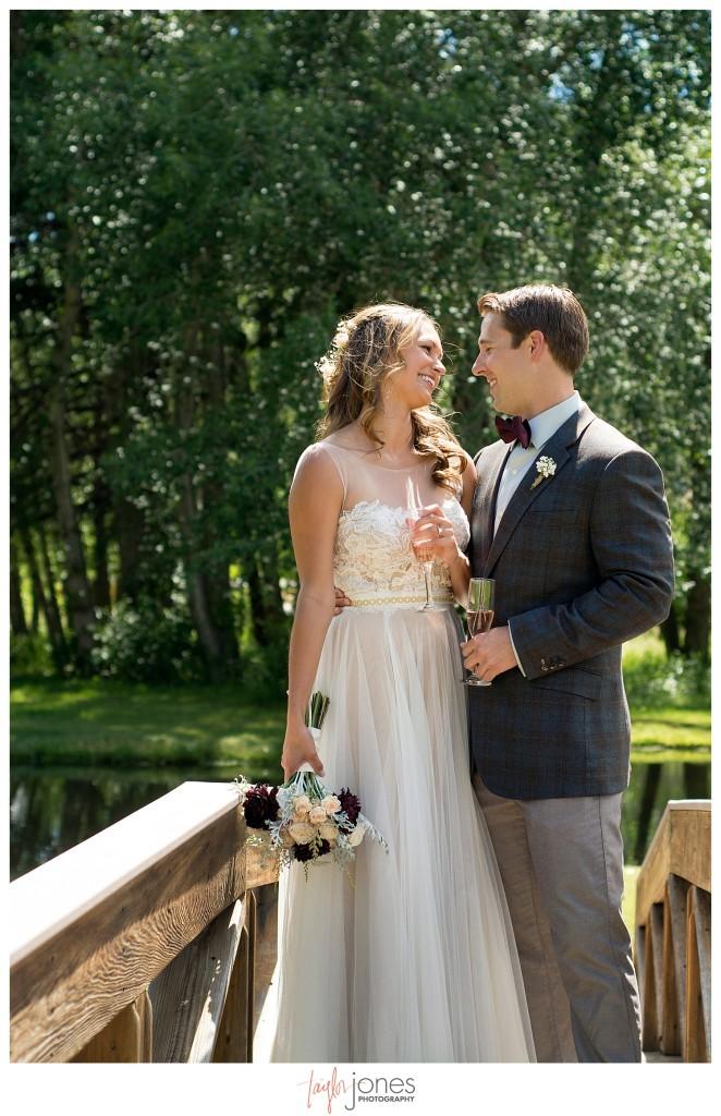 Black Canyon Inn Estes Park wedding first look with bride and groom on a bridge