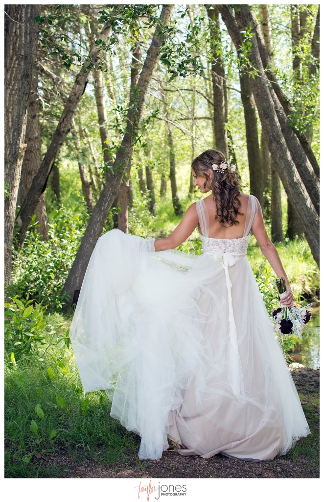 Black Canyon Inn Estes Park wedding first look with bride and groom portraits