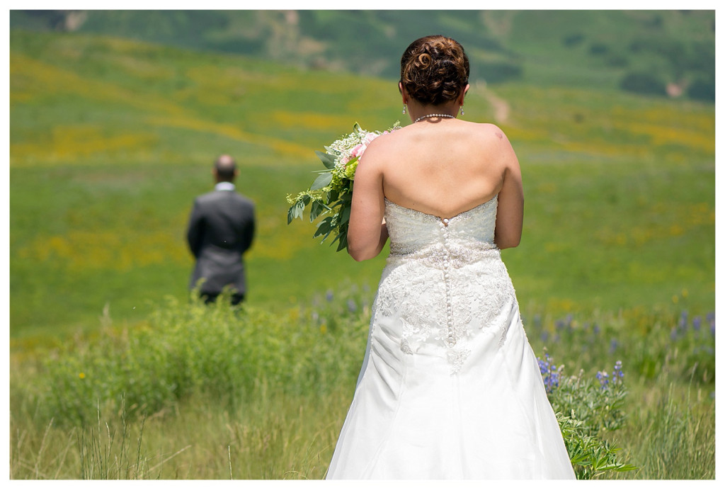 Crested Butte Colorado summer wedding first look at Elk Mountain Range