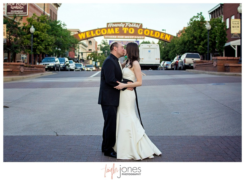 Bride and groom in the street in downtown Golden Colorado