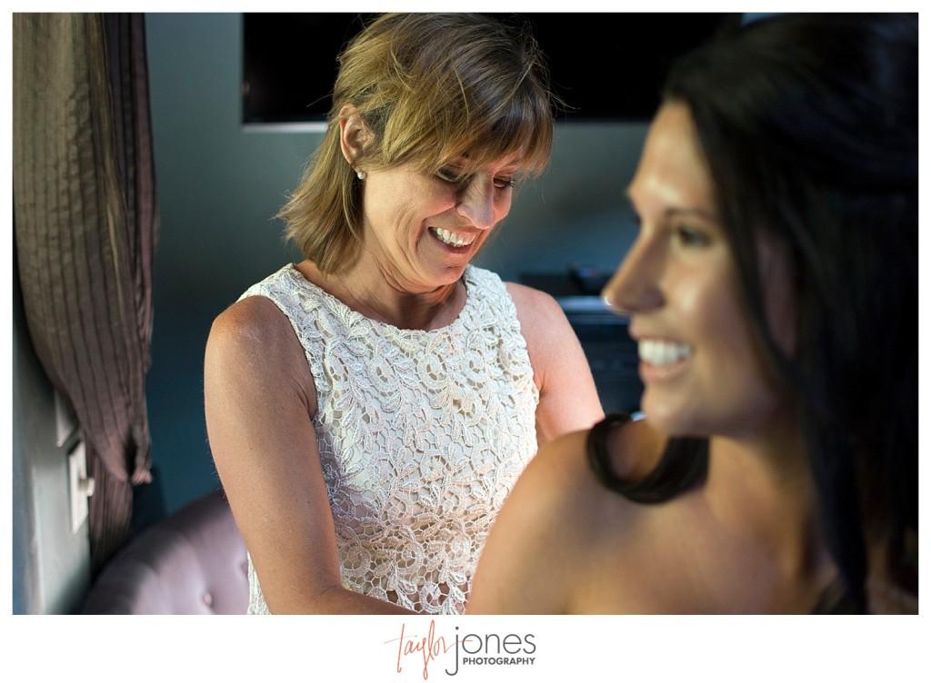 Della Terra Estes Park Wedding bride getting dressed and ready for ceremony