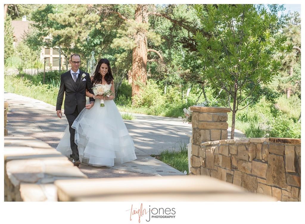 Della Terra Estes Park wedding ceremony bride coming down aisle