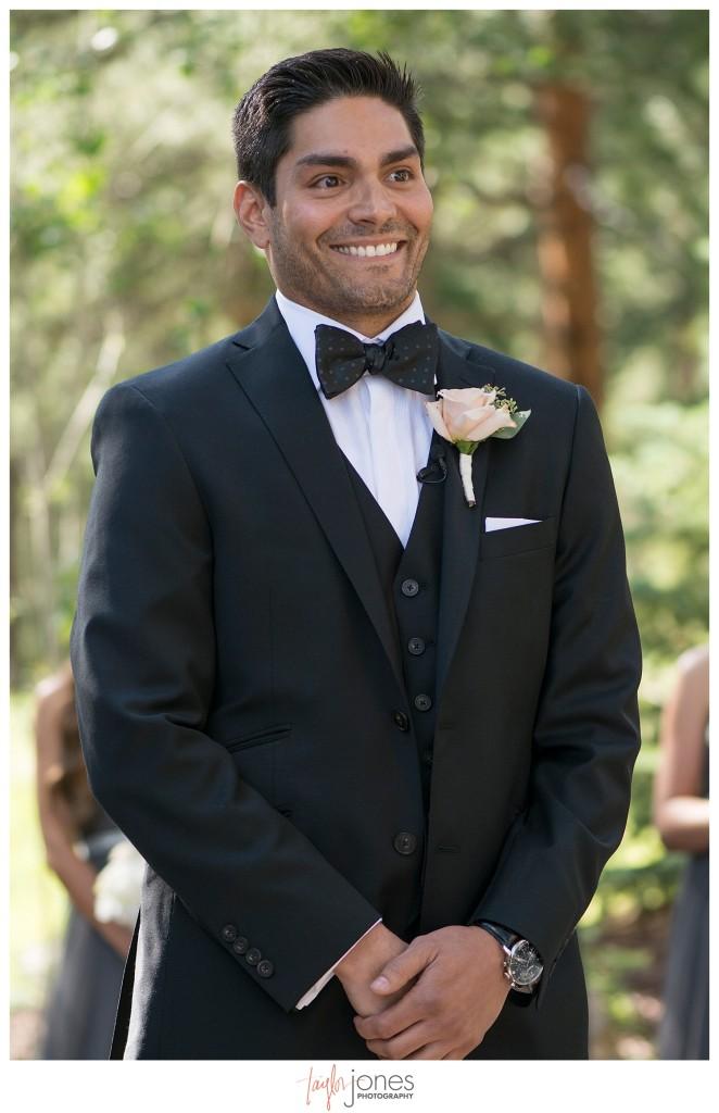Della Terra Estes Park wedding ceremony groom first look