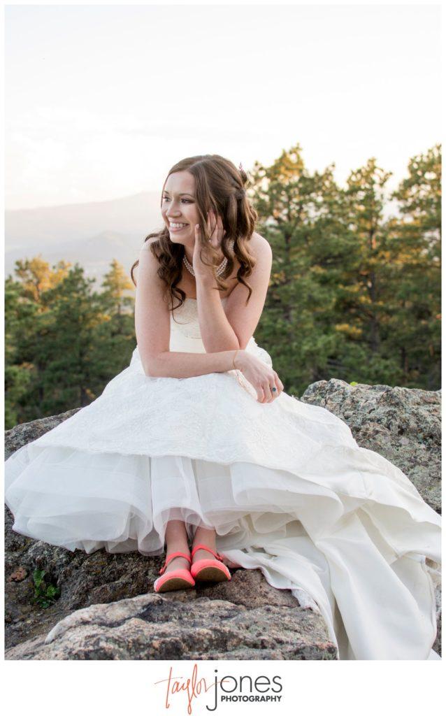 Bride on a mountain in Genesee Colorado wedding photographer