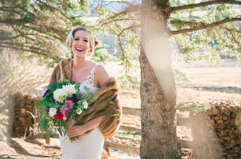 Bride laughing at Deer Creek Valley Ranch wedding Bailey Colorado