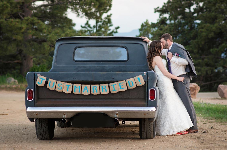 Bride and groom with vintage truck at Genesee Colorado wedding