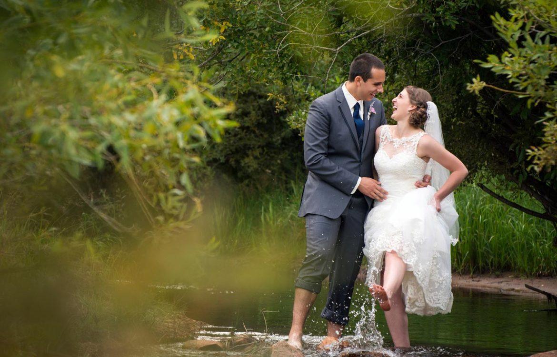 Couple in river at Pine Vally Ranch Pine Colorado wedding