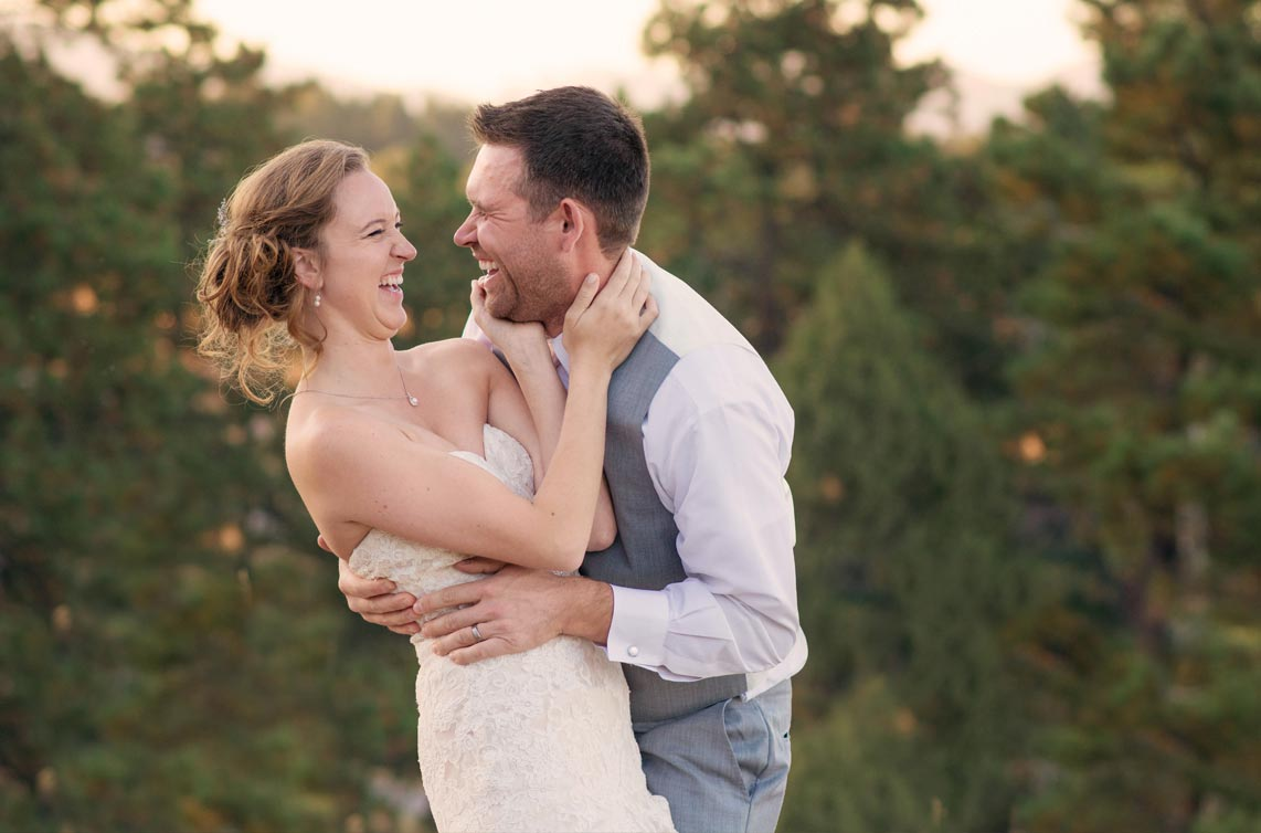 Couple laughing at Pines at Genesse wedding Colorado