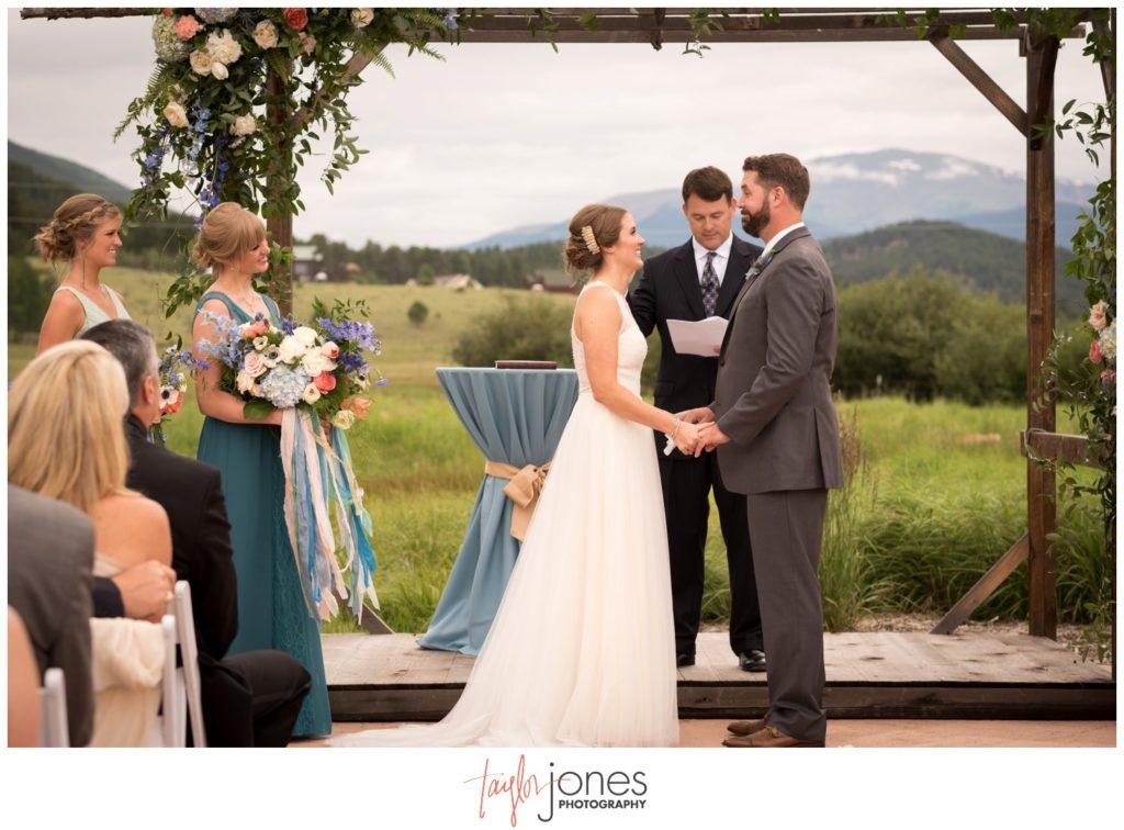 Deer Creek Valley Ranch wedding ceremony in the meadow