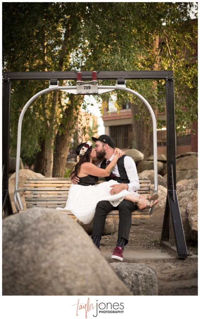 Couple at Salida SteamPlant wedding in ski lift chair