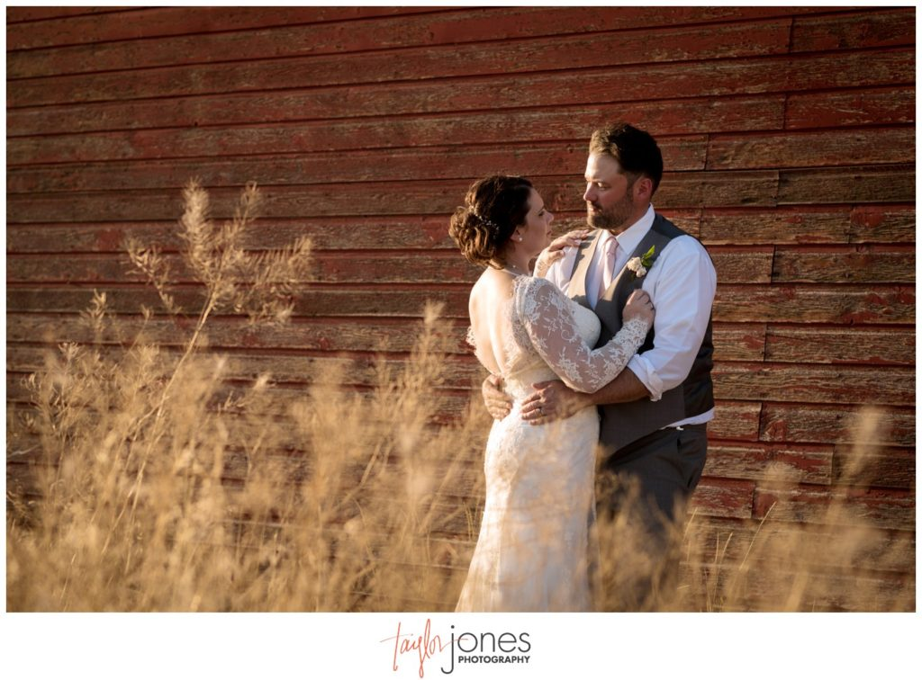 Missoula Montana wedding photographer at the Missoula Winery with couple at red barn