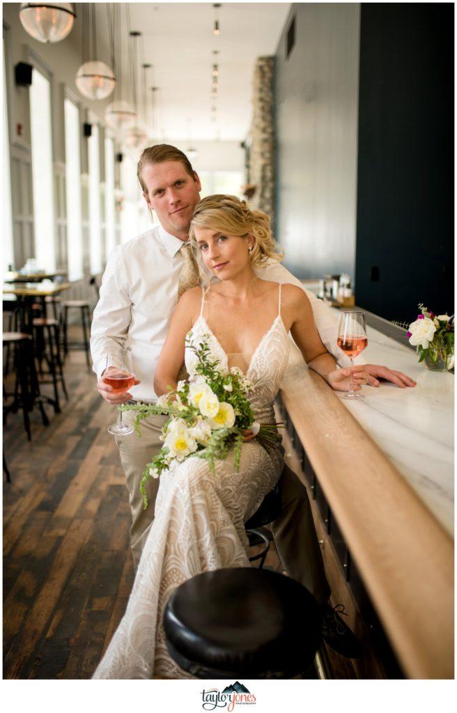 Wedding at the Surf Hotel Buena Vista Colorado bride and groom having a drink at bar