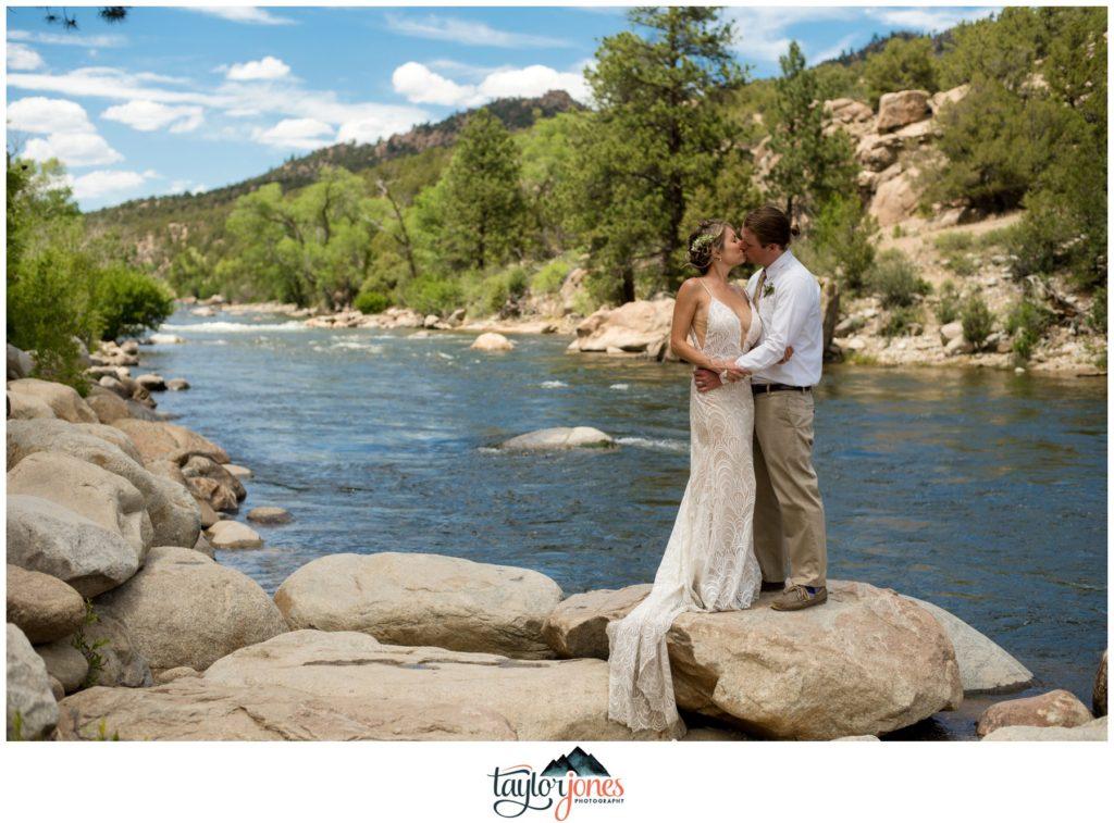 Wedding at the Surf Hotel Buena Vista Colorado bride and groom at the Arkansas river