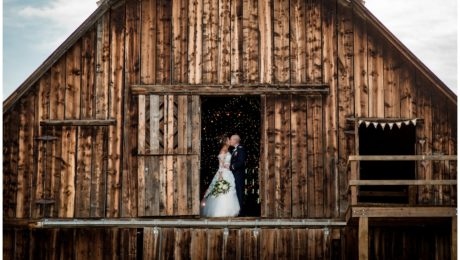Winding River Ranch Wedding of Mike and Melissa wedding bride and groom couple portraits in barn