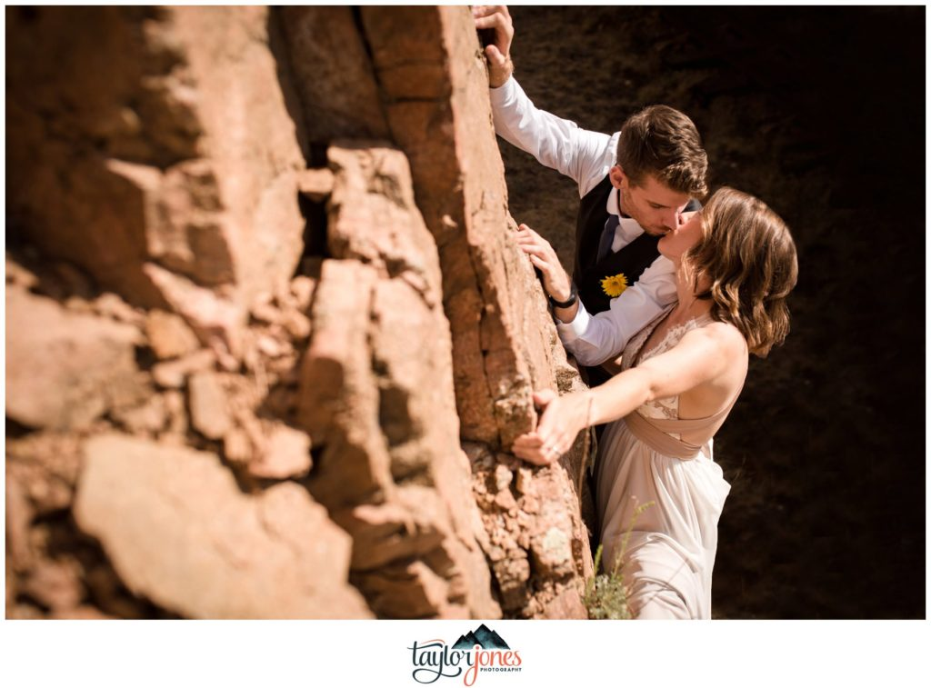 Eden West Ranch Wedding bride and groom climbing portraits